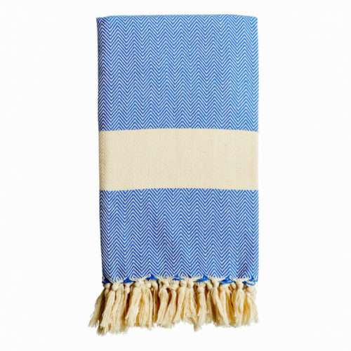 The Ferah is a classic herringbone weave soft cotton peshtemal in sky blue with ecru block stripe, finished with hand knotted tassels. GOTS certified organic cotton.