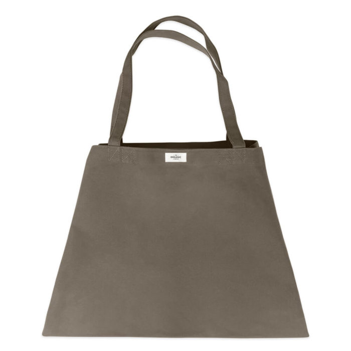 Carry your life around in style with this large overnight bag in organic cotton. This huge bag is practical and unique, perfect as a day bag, or used for going to yoga, the gym. The large size also makes it suitable as a lightweight weekend bag. Available in clay, black, dark blue and stone (seen here in clay). Size: 90 X 45 X 35 cm