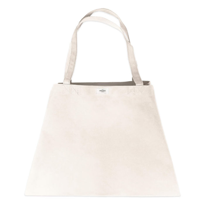 Carry your life around in style with this large overnight bag in organic cotton. This huge bag is practical and unique, perfect as a day bag, or used for going to yoga, the gym. The large size also makes it suitable as a lightweight weekend bag. Available in clay, black, dark blue and stone (seen here in stone). Size: 90 X 45 X 35 cm
