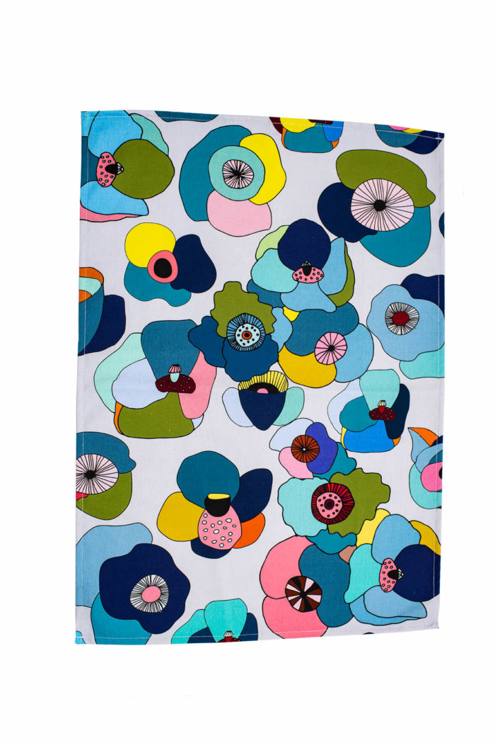 """Bright and colourful floral tea towel featuring hand-drawn summer flowers. This Poppy botanical tea towel comes in two bold designs, in red and blue. Choose from a repeated pattern (""""Pattern"""") or a single motif (""""Portrait""""). Seen here is Blue Pattern. The shapes and colours are evocative of fun retro designs from Scandinavia. 70 x 50cm"""