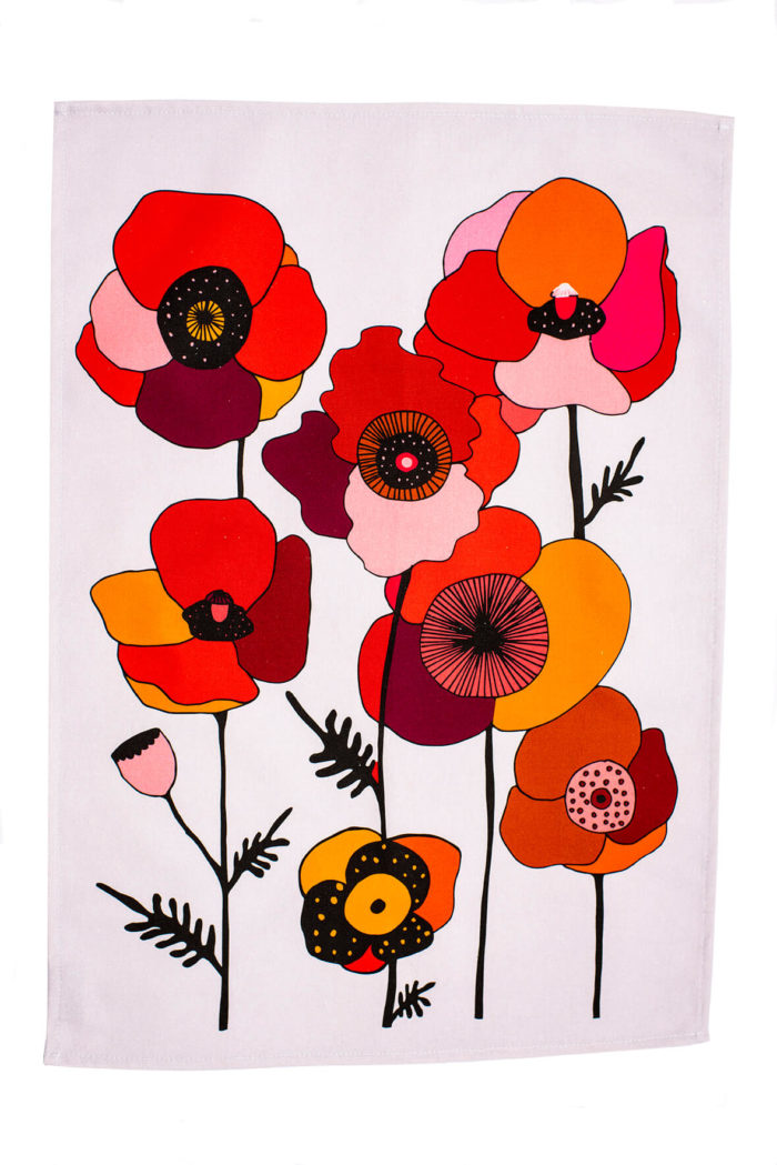 """Bright and colourful floral tea towel featuring hand-drawn summer flowers. This Poppy botanical tea towel comes in two bold designs, in red and blue. Choose from a repeated pattern (""""Pattern"""") or a single motif (""""Portrait""""). Seen here is Red Pattern. The shapes and colours are evocative of fun retro designs from Scandinavia. 70 x 50cm"""