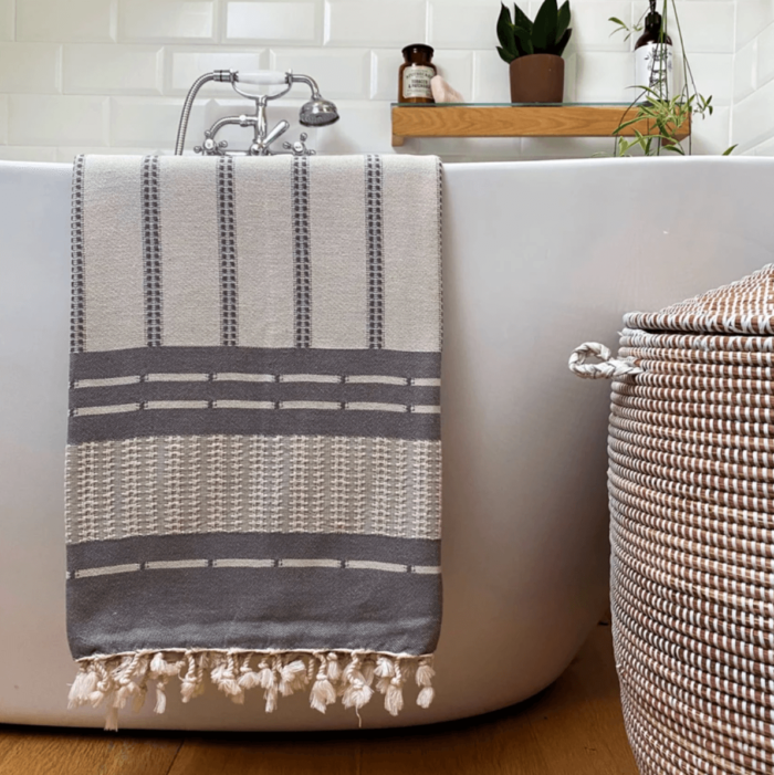 Defne are super soft and sumptuous, jacquard loomed peshtemals in organic cotton, perfect for cooler seasons. 90 x 175 cm. Seen here with one side of the reversible Ash.