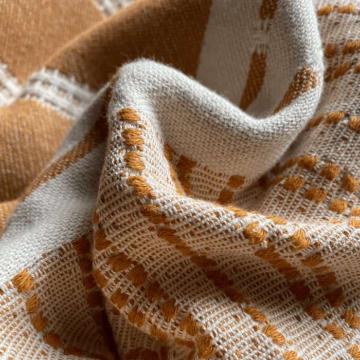 Defne are super soft and sumptuous, jacquard loomed peshtemals in organic cotton, perfect for cooler seasons. 90 x 175 cm. Seen here in close up of the tan colour.